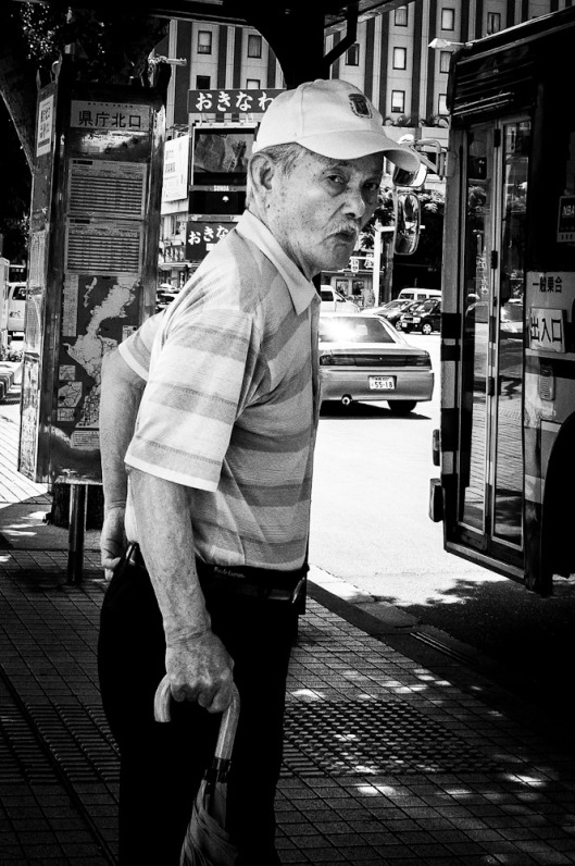 Photo of man waiting for bus